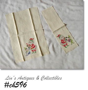 VINTAGE SET OF 2 HAND EMBROIDERED SANTA CHRISTMAS TOWELS