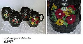 McCOY POTTERY -- BLACK WITH FLOWERS BARREL MUGS
