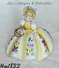 LEFTON -- GIRL WITH FLOWERS FIGURINE