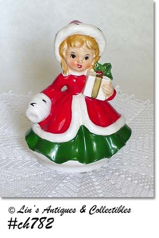 VINTAGE MUSICAL CHRISTMAS GIRL FIGURINE