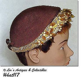 BROWN HAT WITH ATTACHED LEAVES AND BERRIES