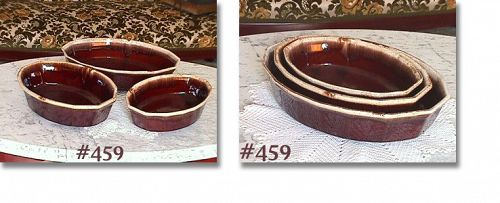 McCOY POTTERY -- BROWN DRIP NESTED OVAL CASSEROLES (3)