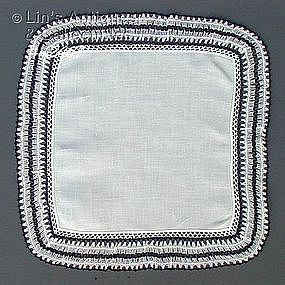 WHITE HANDKERCHIEF WITH BLACK AND WHITE CROCHET EDGING