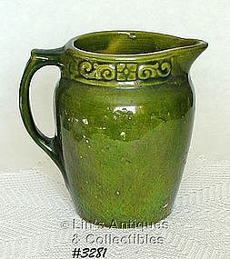 McCOY POTTERY -- GREEN STONEWARE PITCHER