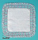 WHITE HANDKERCHIEF WITH PINK AND BLUE CROCHET