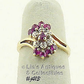 10K RING WITH RUBIES AND DIAMONDS (SIZE 4 1/2)