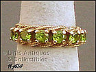 10K PERIDOT BAND RING (SIZE 6 1/2)
