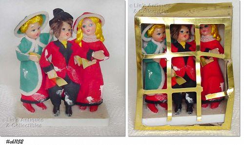 3 CAROLERS ON BASE WITH ORIGINAL BOX