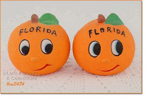 FLORIDA SOUVENIR ANTHROPOMORPHIC ORANGES SHAKER SET