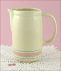 McCOY POTTERY � PINK AND BLUE PITCHER (7�)