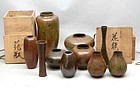 Attractive group of 10 bronze flower vases.