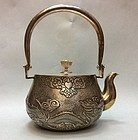 Exceptional  silver tea kettle with embossed Dragon design