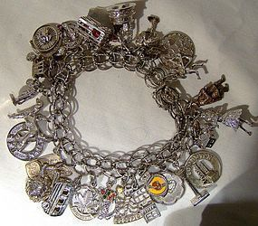 STERLING CHARM BRACELET with 28 CHARMS