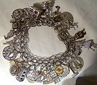 Vintage STERLING CHARM BRACELET with 28 CHARMS