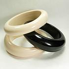 1970s Set 3 Tribal Style Ivory Ebony Lucite Bracelets