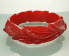 Cherry Red Deeply Carved Leaf Form Bakelite Bangle