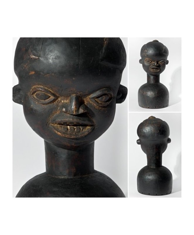 Well carved helmet mask of the Bamileke People Cameroon 1950