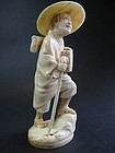 Japanese Ivory Okimono of a Traveller, Signed Eishin