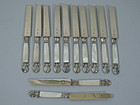 12 French Restauration Silver Gilt and Mother of Pearl Fruit Knives