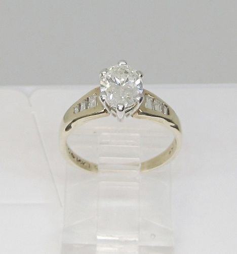 Oval Diamond Engagement Ring in 14 Kt Gold Setting
