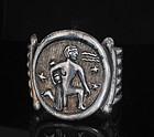 exceptional Mexican silver repousse clamper Bracelet Aquarius