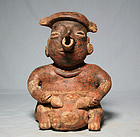 Pre-Columbian Nayarit male figure with Sea Turtle shell drum ca. 300 a
