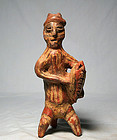 Pre-Columbian Nayarit male Kokopelli with wood rasp drum ca. 300 ad