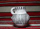 Anasazi/Snow Flake black on white bird effigy mug ca. 1100 ad.