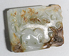 A Chinese pale green and russet jade plaque, 17th ~ 18th century.