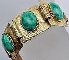 Fancy Gold Colored Bracele Marbeled Green Cabochon