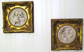Pair of French Bisque Relief Plaques