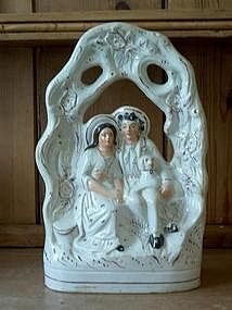 Staffordshire Figure of a Man,Woman and Dog