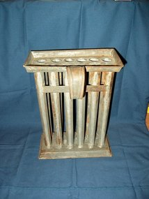A Country Primitive Tin 12-Candle Wax Mold