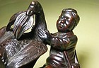 A Lovely Wood Carving of A Child & A Goose