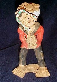 Peruvian clay figure ofman with burden basket souvenir