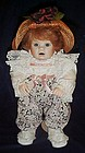 "Porcelain doll with ""Patches"" head dressed nicely"