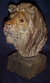 Hand carved lions head with glass eyes