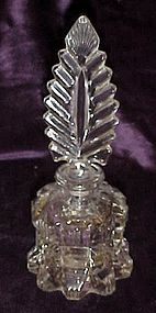 Old fancy glass perfume bottle with feather  stopper