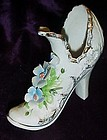 Vintage porcelain shoe with applied  flowers