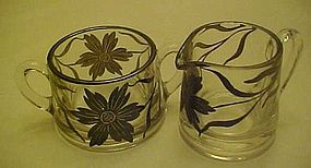 old glass creamer and sugar set with silver overlay