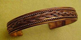 Copper cuff bracelet with rope and braid