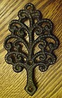 Vintage miniature cast Iron tree trivet MT3