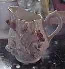 Vintage miniature porcelain creamer with pink roses