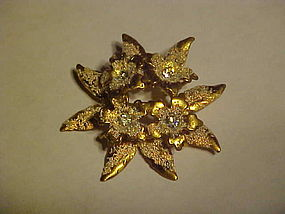 Goldtone flower pin with rhinestones AUSTRIA