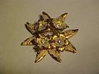 Goldtone flower pin with rhinestones AUSTRIA