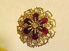 Vintage red enamel and rhinestone filigree pin