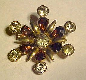 Vintage snowflake style rhinestone pin with purple