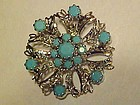 Vintage silver and turquoise rhinestone snowflake pin