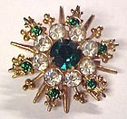 Vintage rhinestone snowflake pin with emerald green