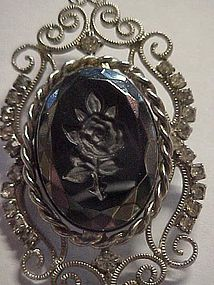 Rhinestine pin with black carved rose center